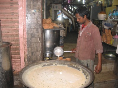 Pouring the hot milk into earthen cups