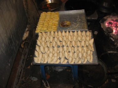 samosas and cutlets waiting to be fried