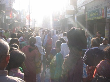 the lines blurred by the scores of people going to the Ghats
